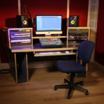 Empty office chair in front of audio equipment