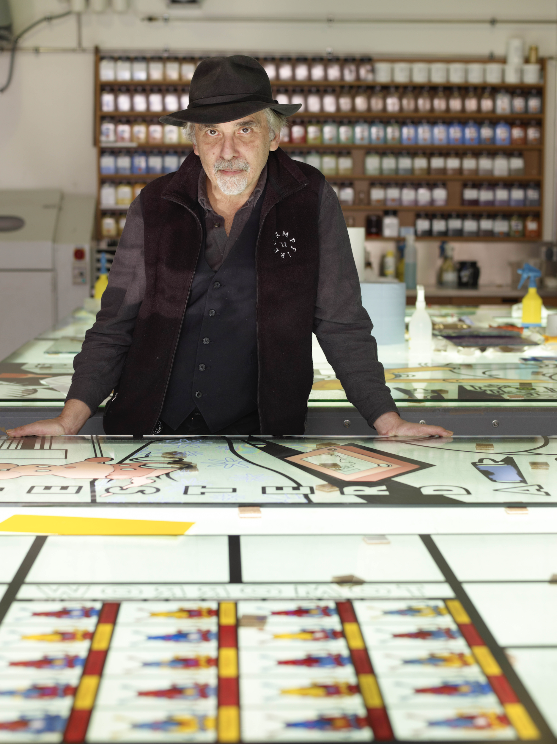 Art Spiegelmann, Cartoonist, standing at a table with a hat